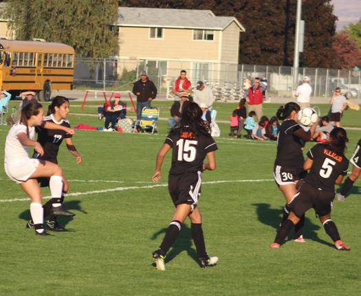 Lady Bears senior midfielder Marlisa Garcia (1) left, gets a kick past several Bridgeport defenders during last Thursday's league battle.