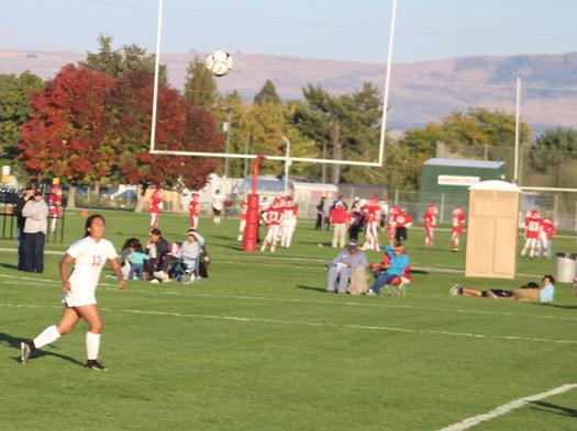 The ball sails past Brewster senior forward Yvette Sanchez (13)…