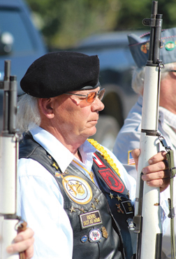 Bill Shenyer stands at present arms during one of the five ceremonies performed by Columbia Post 97 during Memorial Day last Monday.