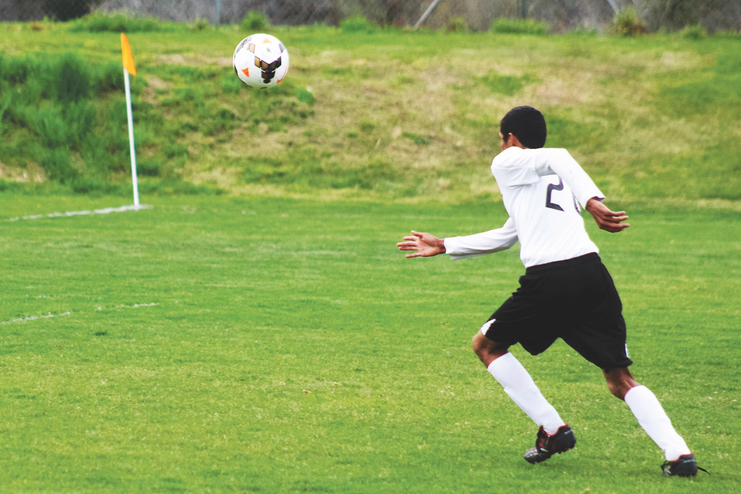 Bridgeport sophomore midfielder, Carlos Mariles presses the attack on the Oroville goal in last Thursday's home soccer match…