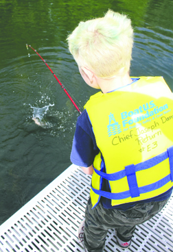 """It's """"Fish On!"""" for 8-year-old Colton Dezellem at last Saturday's Hooked on Kids Fishing Derby in Bridgeport's Marina Park cove."""