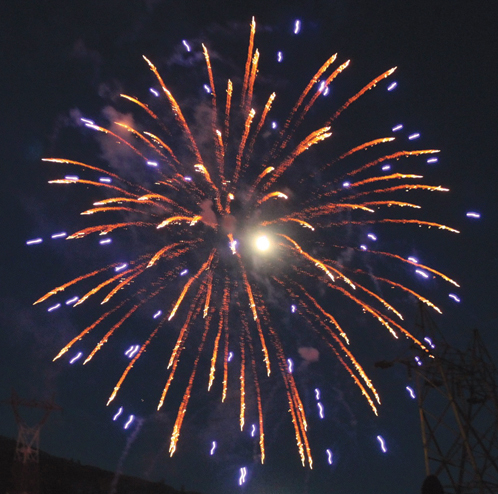 The gibbous moon appeared to be the source of this colorful fireworks explosion.