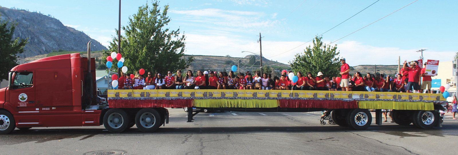 Honey Bear employees piled on a flatbed trailer made up the parade's largest contingent.