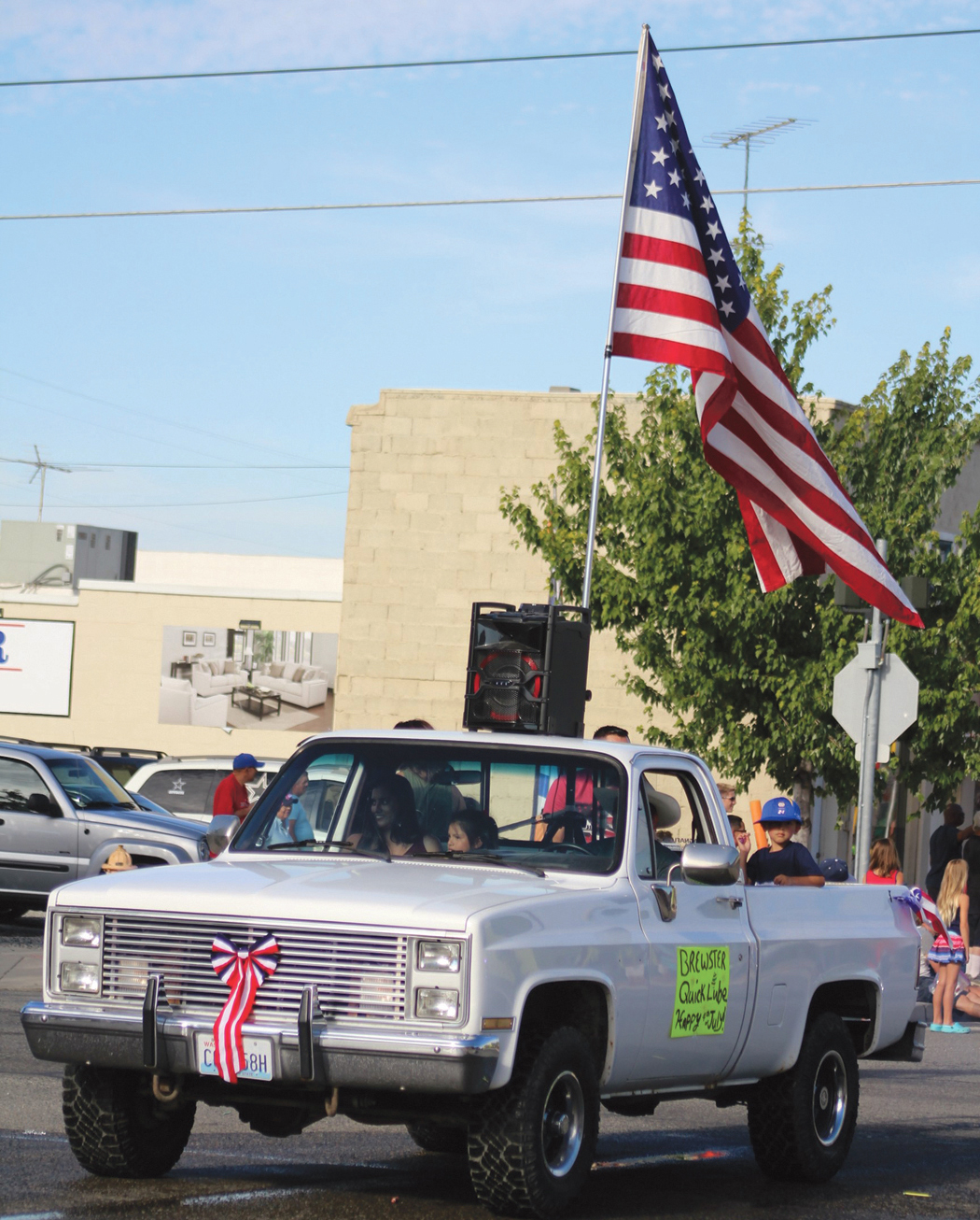The largest flag in the parade belonged to Brewster Quick Lube.