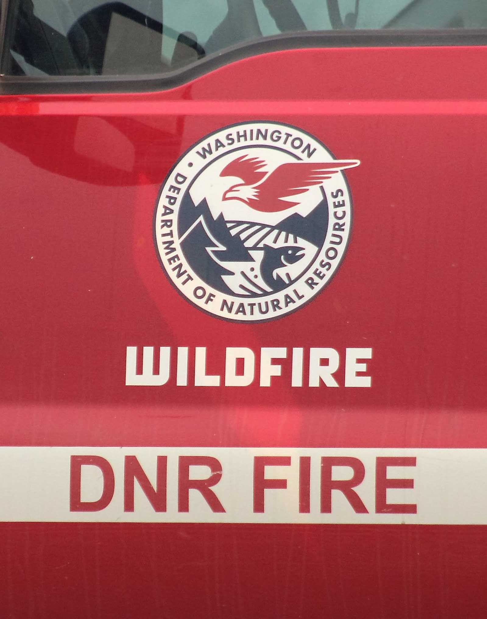 A DNR crew from Twisp was first on the scene as the fire spread.