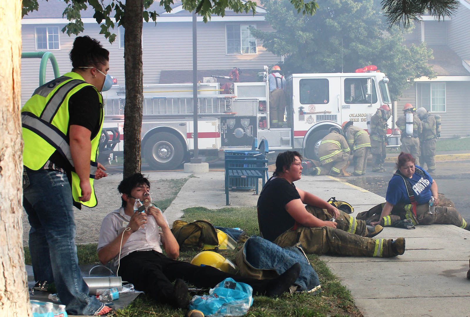 Exhausted firefighters take a break from the heat and smoke.