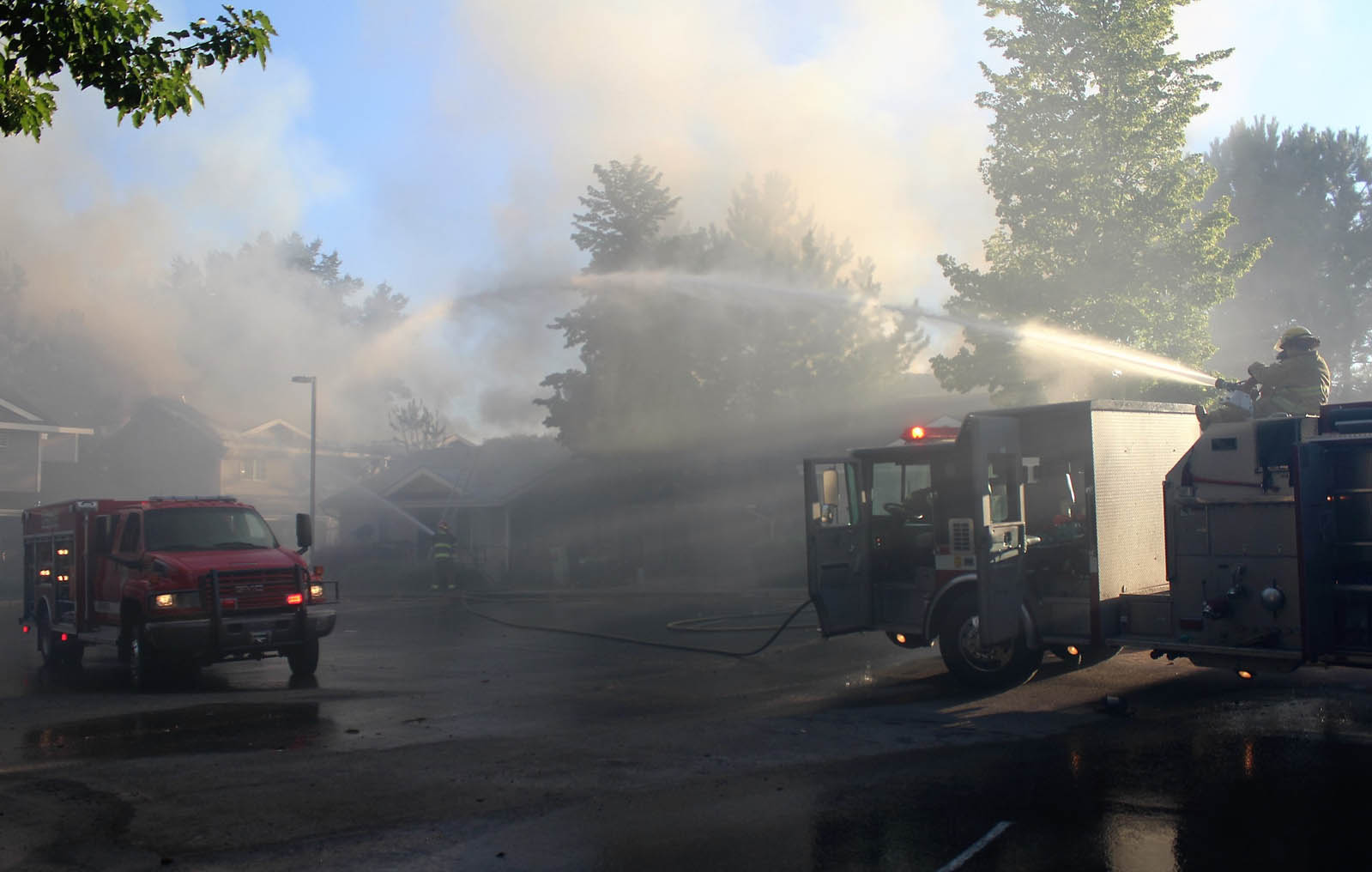 A water cannon mounted on a Douglas Okanogan Fire District 15 unit provided a long reach to fight the flames.