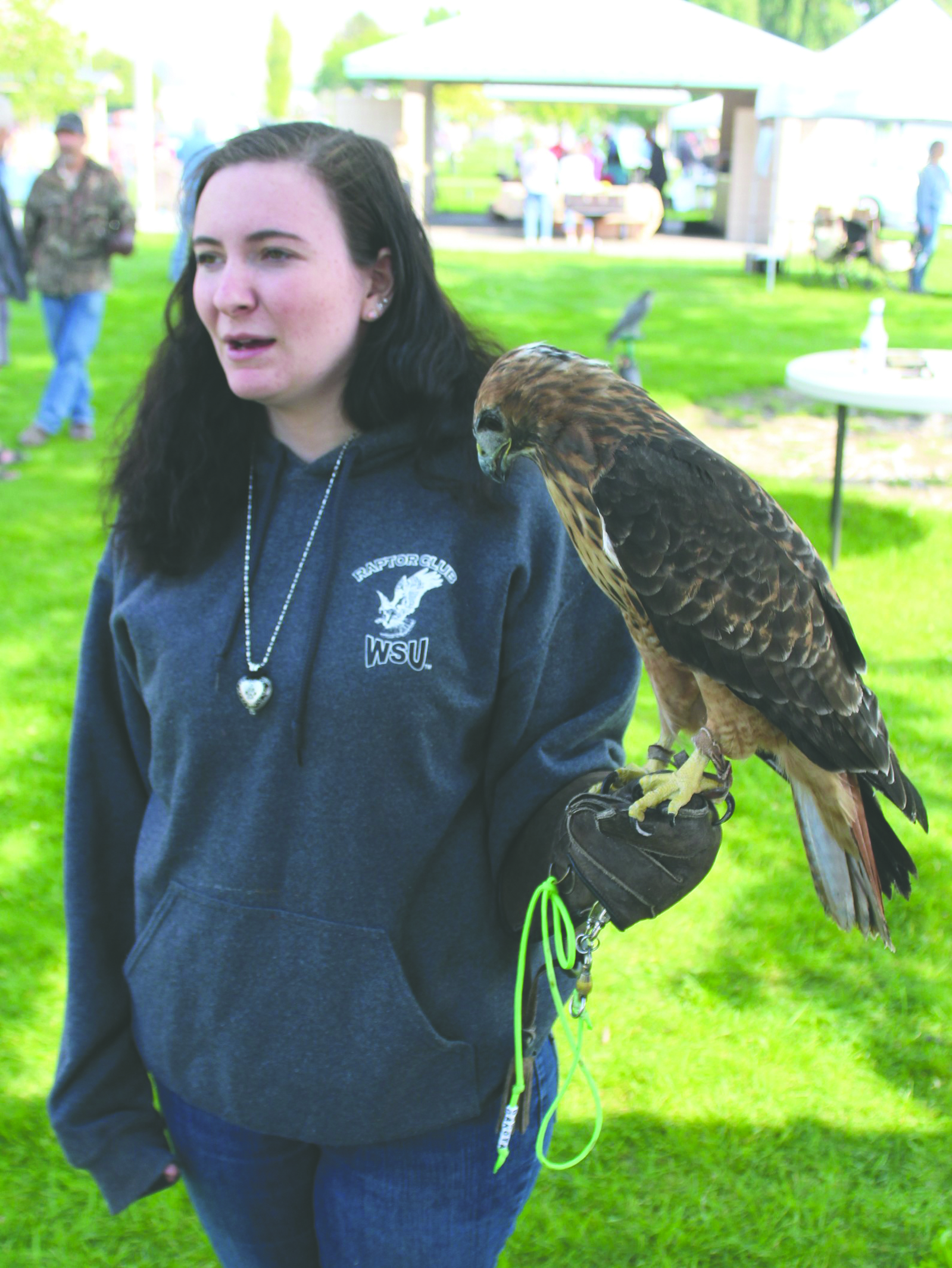 Kalayha Cochran holds Dakota an injured Red-tailed hawk.