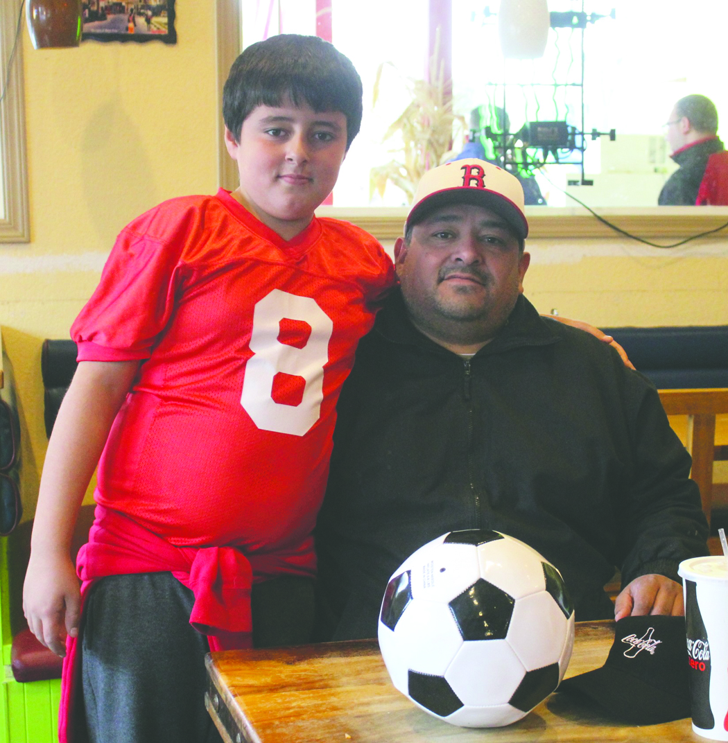 Marine veteran Anthony Ruiz, pictured with son, Braydon, a fourth grader at Brewster, enjoyed lunch at Mi Pueblo Market at 623 W. Main Avenue in Brewster last Saturday. Owners Esteban and Maria Camacho, whose son, Alexis, is a corporal in the Marine Corps, were hosting a lunch special for military veterans.