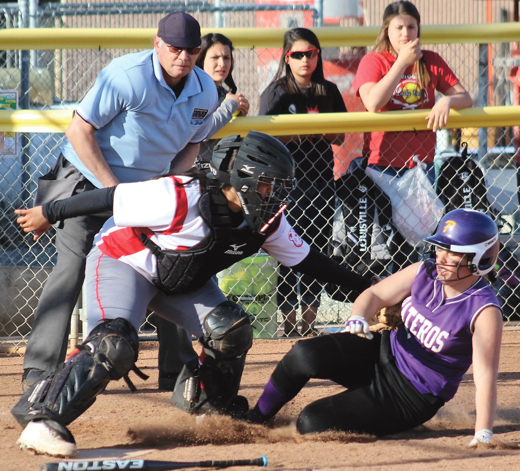Pateros's Andrea Baird tries to beat the tag of Bears catcher Abby Urias at home plate last Friday, April 21.