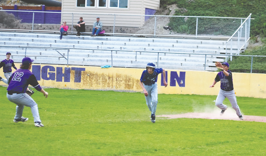 Billygoat, Max Ewing, No. 5, right, cuts off a Manson base runner trying to return to second base during the Pateros Senior Night game last Tuesday, May 2.